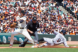 SAN FRANCISCO, CA - APRIL 24: Dee Gordon #9 of the Miami Marlins steals third base ahead of a tag from Matt Duffy #5 of the San Francisco Giants in front of umpire Mark Carlson #6 during the third inning at AT&T Park on April 24, 2016 in San Francisco, California.  (Photo by Jason O. Watson/Getty Images) *** Local Caption *** Dee Gordon; Matt Duffy; Mark Carlson