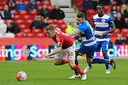 Nottingham Forest midfielder Ben Osborn wins the ball from Queens Park Rangers forward Jamie Mackie during The FA Cup third round match between Nottingham Forest and Queens Park Rangers at the City Ground, Nottingham, England on 9 January 2016. Photo by Aaron Lupton.