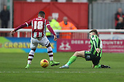 Jake Reeves of AFC Wimbledon stops Jamie Reid of Exeter City in his tracks during the Sky Bet League 2 match between Exeter City and AFC Wimbledon at St James' Park, Exeter, England on 28 December 2015. Photo by Stuart Butcher.