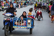 09 JULY 2013 - PATTANI, PATTANI, THAILAND: Muslim women in the market in Pattani.  Pattani, along with Narathiwat and Yala, are the only three Muslim majority provinces in Thailand.     PHOTO BY JACK KURTZ
