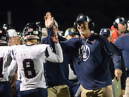 Central Bucks East's Wes Verbit (8) is congratulated on the sideline after scoring a touchdown against Council Rock North in the first quarter at Council Rock North Saturday October 15, 2016 in Newtown, Pennsylvania.  (Photo by William Thomas Cain)