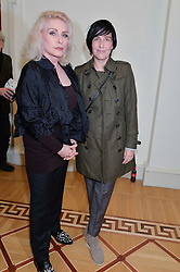 Left to right, DEBBIE HARRY and SHARLEEN SPITERI at a private view of Chris Stein/Negative: Me, Blondie And The Advent Of Punk, held at Somerset House, The Strand, London on 5th November 2014.