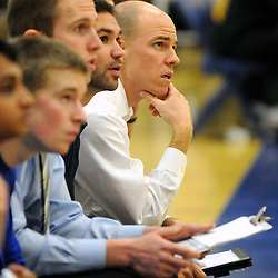 Staff photos by Tom Kelly IV<br /> Downingtown East's head coach (far right) on the bench during the Downingtown East vs Ben Franklin game at Downingtown West High School on Friday December 6, 2013.