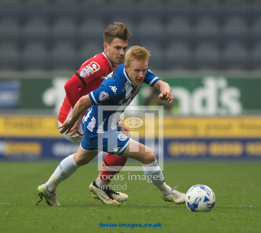 David Perkins of Wigan Athletic collects the ball during the Sky Bet League 1 match at the DW Stadium, Wigan<br /> Picture by Russell Hart/Focus Images Ltd 07791 688 420<br /> 03/10/2015