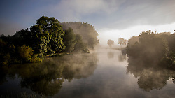 © Licensed to London News Pictures. 11/09/2016. Reading, UK.  Early morning sunshine over a misty river Thames near Reading. A period of warm weather is expected in mid September.Photo credit: Peter Macdiarmid/LNP
