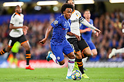 Chelsea midfielder Willan (10) goes past Valencia CF midfielder Daniel Parejo (10) during the Champions League match between Chelsea and Valencia CF at Stamford Bridge, London, England on 17 September 2019.