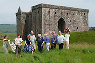 Smailholm Stitching group portrait for the Great Tapestry of Scotland project. Photographed at Hermitage Castle to reference the Reivers on one of their panels<br /> <br /> www.scotlandstapestry.com<br /> <br /> pictures by Alex Hewitt