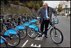 The London Mayor Boris Johnson with a  Barclays Bike in Wandsworth as he expands the Barclays Cycle Hire to Wandsworth, South West London, United Kingdom. Friday, 13th December 2013. Picture by Andrew Parsons / i-Images