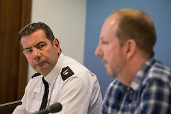 © Licensed to London News Pictures . 30/12/2013 . Manchester , UK .  CHIEF SUPERINTENDENT NICK ADDERLEY listens  to Adam Pickup's dad, CHRIS PICKUP , as he delivers a media appeal this afternoon (30th December 2013) as this evening Greater Manchester Police have announced that they have found Adam dead following an wide search for the 17 year old , who went missing during the early hours of Saturday 28th December . Photo credit : Joel Goodman/LNP