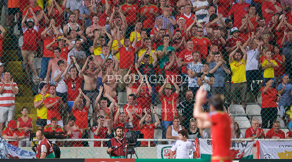 NICOSIA, CYPRUS - Thursday, September 3, 2015: Wales' Gareth Bale applauds the supporters as he is substituted during the UEFA Euro 2016 qualifying match against Cyprus at the GPS Stadium. (Pic by David Rawcliffe/Propaganda)