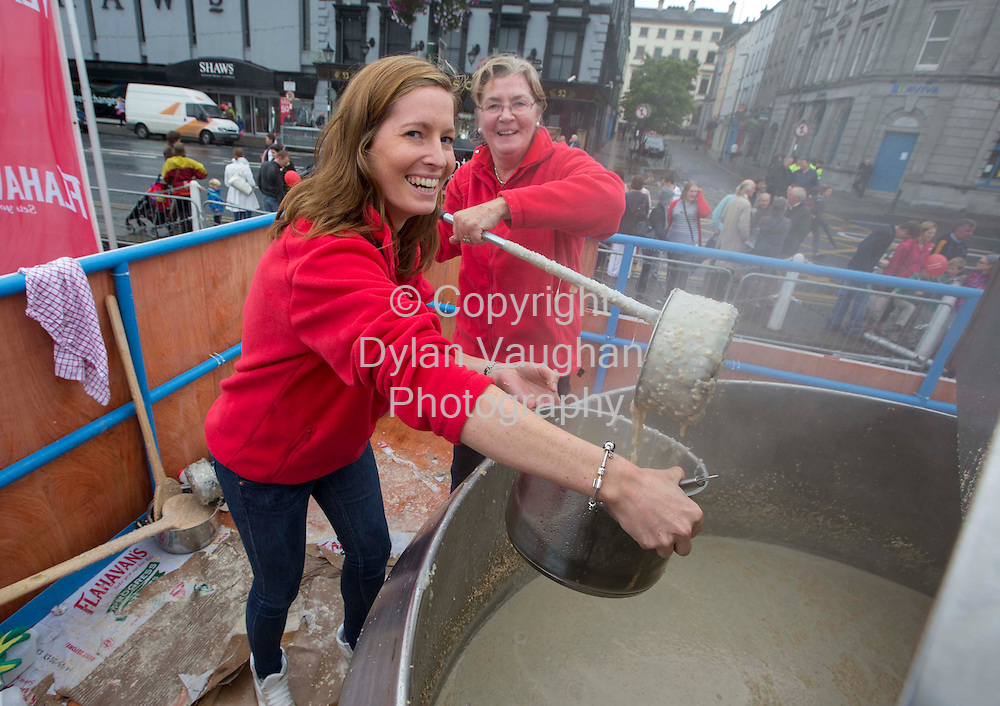 Repro Free..16/9/2012.Organiser's of Ireland's biggest food festival 'Harvest' in conjunction with Flahavan's have cooked up the World's largest bowl of porridge weighing in at 1380Kg today at the Waterford Harvest Festival. (Sunday, September 16, 2012)...Pictured at the attempt was from left Ellen Flahavan and Mary Flahavan...Picture Dylan Vaughan....The official attempt was carried out on the Quayside in Waterford city at the Harvest Festival and is to be verified by Guinness in the coming weeks...The huge breakfast of 1380Kg of porridge has exceeded the target of 914Kg, the year the city of Waterford was founded. During the process a specially-made bowl measuring 1.4 metres in height and 1.7 metres in diameter was used...The world record attempt for the largest bowl of porridge began at 7am and finished at 1pm, taking approximately 6 hours to cook. The world's largest bowl of porridge produced over 5,500 servings and was enjoyed by all attending the Festival...Flahavan's, producers of Ireland's most popular porridge are thrilled with the new world record. Commenting on the challenge John Flahavan said, ?We are thrilled that this record success has been brought to Waterford and Ireland for the first time. A great deal of planning and organizing has gone into the event prior to cooking up the 1380Kg of porridge. We are very grateful to all customers who came here today to support our record attempt. We also wish to thank all our staff, the Harvest Festival Committee and the Lions Club volunteers for all their help and support today.