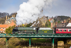 "© Licensed to London News Pictures. 09/04/2018. Ruswarp UK. The 1934 Steam Locomotive 926 ""Repton"" travels across the River Esk in the village of Ruswarp in The North Yorkshire Moors this morning on it's way from Whitby to Pickering. The engine built in 1934 & Known as Repton was built in Eastleigh & designed by Richard Maunsell, it is known as a SR Class V ""Schools"" & worked the Southern Railway & British Railways lines. Photo credit: Andrew McCaren/LNP"