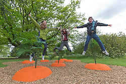 "© Licensed to London News Pictures. 23/05/2013. London, England. Pictured: Kew interns Rebecca, Valentina and Alex test out the Bouncy Carrot Patch. Kew Gardens launches summer festival ""IncrEdibles"" with a ""Tutti Frutti Boating Experience"" on Palm House Pond designed by Bompas & Parr, a ""Bouncy Carrot Patch"" and an ""Alice in Wonderland""-inspired Tea Party in the Rose Garden. The Festival runs from 25 May to 3 November 2013, boating finishes 1 September. Photo credit: Bettina Strenske/LNP"