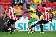 Lincoln - Wednesday, July 28th, 2010: Lincoln's'  Mustapha Carayol challenges Norwichs's Anthony Mcnamee during the Pre Season friendly match at Sincil Bank. (Pic by Andrew Stunell/Focus Images)