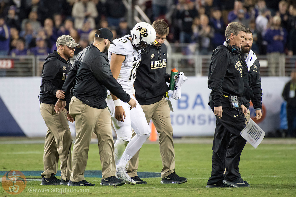 December 2, 2016; Santa Clara, CA, USA; Colorado Buffaloes quarterback Sefo Liufau (13) is looked at after an injury during the first quarter in the Pac-12 championship against the Washington Huskies at Levi's Stadium.