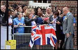 Royal fans and Hospital staff wait to see the New Royal Baby outside the Lindo Wing at St.Mary's hospital in London following the birth of the Royal baby, Tuesday, 23rd July 2013<br /> Picture by Andrew Parsons / i-Images