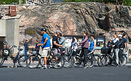 Helsinki, Finland -- July 19, 2019. Photo of cyclists stopping for a rest outside the Rock Church in Helsinki, Finland.