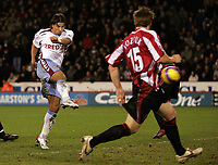 Photo: Paul Thomas.<br /> Sheffield United v Aston Villa. The Barclays Premiership. 11/12/2006.<br /> <br /> Milan Baros (C) of Villa scores.
