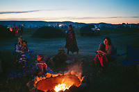 Bismarck, North Dakota<br /> <br /> Members of the Onondaga Nation, including, from left, Amber Lane, her sons Jaxon Lane, 5, and JJ Lane, 10, and Tristyn Jock listen to a member of their nation speak about their mission during the on-going protests near the Standing Rock Sioux Reservation.<br /> <br /> -- <br /> <br /> When visitors turn off a narrow North Dakota highway and drive into the Sacred Stone camp where thousands have come to protest an oil pipeline, they thread through an arcade of flags whipping in the North Dakota wind. Each represent one of 280 Native American tribes that have flocked here in what activists are calling the largest, most diverse tribal action in at least a century, perhaps since Little Bighorn.<br />  <br /> <br /> CREDIT: Alyssa Schukar for The New York Times  <br /> 30195251A