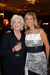 Left to right, DENISE BRYER first wife of Nicholas Parsons and their daughter SUZY PARSONS at the 90th birthday party for Nicholas Parsons held at the Hyatt Churchill Hotel, Portman Square, London on 8th October 2013.