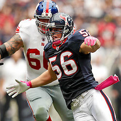 October 10, 2010; Houston, TX USA; Houston Texans linebacker Brian Cushing (56) rushes past New York Giants offensive tackle David Diehl (66) during the first half at Reliant Stadium. Mandatory Credit: Derick E. Hingle