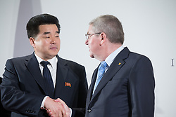 LAUSANNE, Jan. 20, 2018  International Olympic Committee (IOC) President Thomas Bach (R) shakes hands with Kim Il Guk, the president of the Olympic Committee of the Democratic People's Republic of Korea (DPRK) in Lausanne, Switzerland on Jan.20, 2018. (Credit Image: © Xu Jinquan/Xinhua via ZUMA Wire)