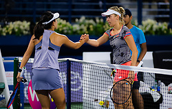 February 18, 2019 - Dubai, ARAB EMIRATES - Lin Zhu of China & Elise Mertens of Belgium at the net after their first round match at the 2019 Dubai Duty Free Tennis Championships WTA Premier 5 tennis tournament (Credit Image: © AFP7 via ZUMA Wire)