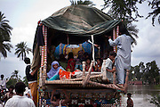 Muzzafargarh: men, women and children hitch a ride aboard a tractor and trailer fleeing rising floodwater near the town of Baseera in the district of Muzzafargarh...Flood waters continued to cause havoc in South Punjab.