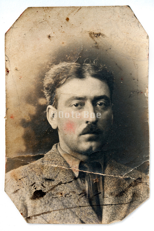 damaged vintage identity style head and shoulder portrait of a adult man