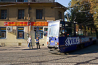 blue number 75 tram on linia czasowa leaves krakow old town on sunny afternoon in september 2005