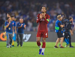 NAPLES, ITALY - Tuesday, September 17, 2019: Liverpool's Virgil van Dijk applauds the supporters after the UEFA Champions League Group E match between SSC Napoli and Liverpool FC at the Studio San Paolo. Napoli won 2-0. (Pic by David Rawcliffe/Propaganda)