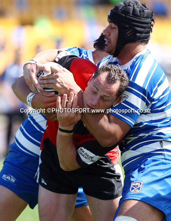 Bulls Jonny Limmer is tackled.<br />