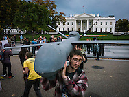 Nov. 2, 2013, Washington, DC. Activists with Amnesty International protested drone executions and extrajudicial power. They marched through city streets to the White House.