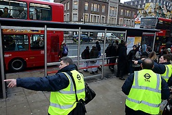 Tube Strike. London transport officers help the commuters at King's Cross Station. King's Cross Station, London, United Kingdom. Wednesday, 5th February 2014. Picture by Peter Kollanyi / i-Images