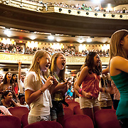 May 26, 2012 - New York, NY : Fans scream as they wait for pop sensation 'One Direction,' to take the stage for a matinee performance at the Beacon theater in Manhattan on  Saturday afternoon. The group is on the road for their first-ever headlining North American tour in support of their debut album UP ALL NIGHT. CREDIT: Karsten Moran for The New York Times