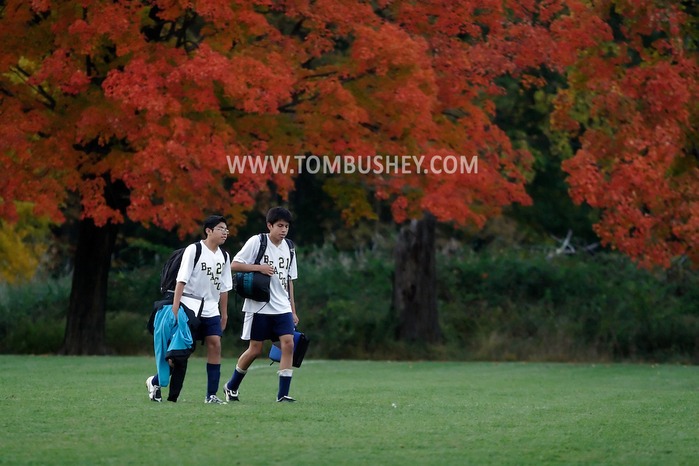 Beacon, NY - Two players walk off the field with their books and equipment after a high school boys' soccer game in Beacon on Oct. 14, 2008.