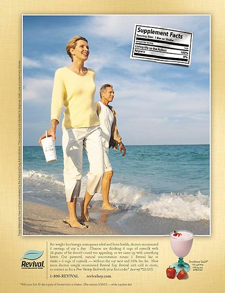 Mature couple walking along surf.