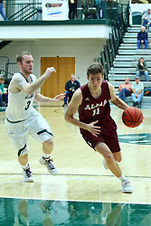 17 November 2017:  Steven Harvey cuts past Nick Coleman during an College men's division 3 CCIW basketball game between the Alma Scots and the Illinois Wesleyan Titans in Shirk Center, Bloomington IL