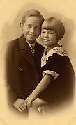 formal portrait of two little children.