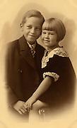 formal portrait of two little children.