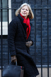 © licensed to London News Pictures. London, UK 14/01/2014. Home Secretary Theresa May leaving Downing Street after a cabinet meeting on Downing Street on Tuesday, 14 January 2014. Photo credit: Tolga Akmen/LNP