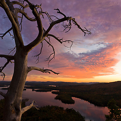 View of Squam Lake from West Rattlesnake Mountain in Holderness, New Hampshire. Fall. Sunset.