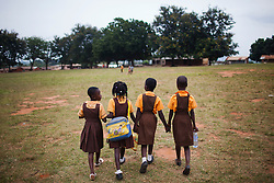 Girls walk home from the primary school in Bosomkyekye  after an art program with CARE staff in conjunction with the celebration for CARE's 20th anniversary in Atlanta.CARE has several programs in this area, including the REGAL program for students and a training program for teachers.