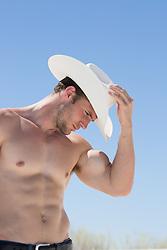 hot shirtless muscular cowboy outdoors