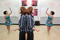 SOTA dance teacher Robin Jaecklein, center, directs Jezlane Bryant and other students during a modern dance class at the school's dance studio located in the former Ted Brown building, one of three main downtown buildings where SOTA holds most classes, December 1, 2011.(Janet Jensen/Staff photographer)