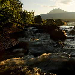 Katahdin Lake as it tumbles into Katahdin Brook near Maine's Baxter State Park.  Mount Katahdin is in the distance.