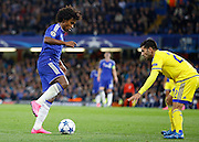 Willian looks to take on Avi Rikan during the Champions League match between Chelsea and Maccabi Tel Aviv at Stamford Bridge, London, England on 16 September 2015. Photo by Andy Walter.