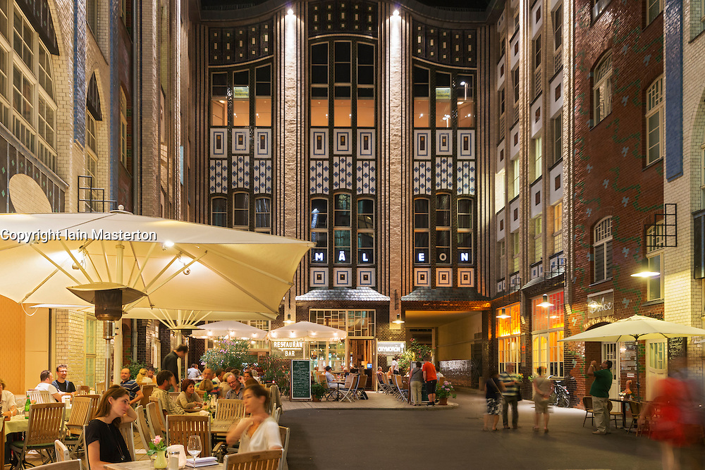 Busy restaurants in courtyard or Hof at Hackesche Hofe at Hackescher Markt in Mitte Berlin Germany