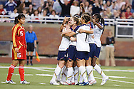 US Woman Celebrate Heather O'Reilly's goal while (15 China) Zhou Gao Ping look on. US Women National Team vs. China. US 1 China 0