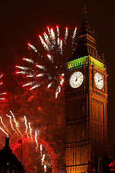 © licensed to London News Pictures. London, UK 02/01/2014. Fireworks set off at midnight on the 1 January 2014 in Westminster, London. Photo credit: Tolga Akmen/LNP